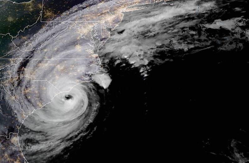 shows the night view of the east coast with a large cyclone cloud almost parallel to southern North Carolina