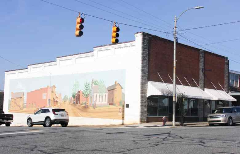 A mural of life in Siler City as it was in 1910 is on an old building. Siler City is the site of a new maternity unit that will be ran by primary care doctors.