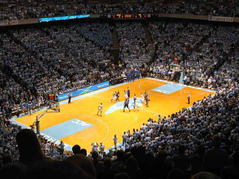 shows basketball players from Duke and UNC on a court