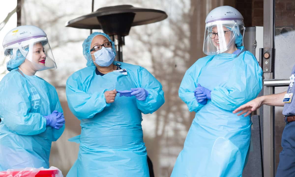 health care workers wearing personal protective equipment, or PPE