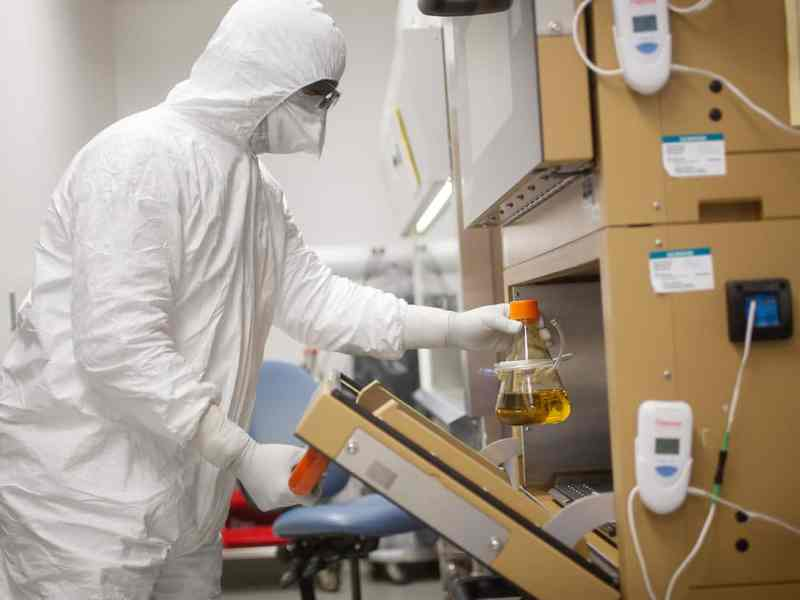The A Duke Vaccine Institute worker in front of a hood. Duke is working to develop a universal flu vaccine.