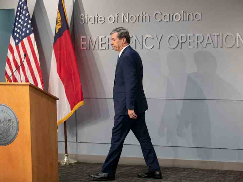 Gov. Roy Cooper is stepping up to the podium before his talk about coronavirus control measures at a press briefing Friday.