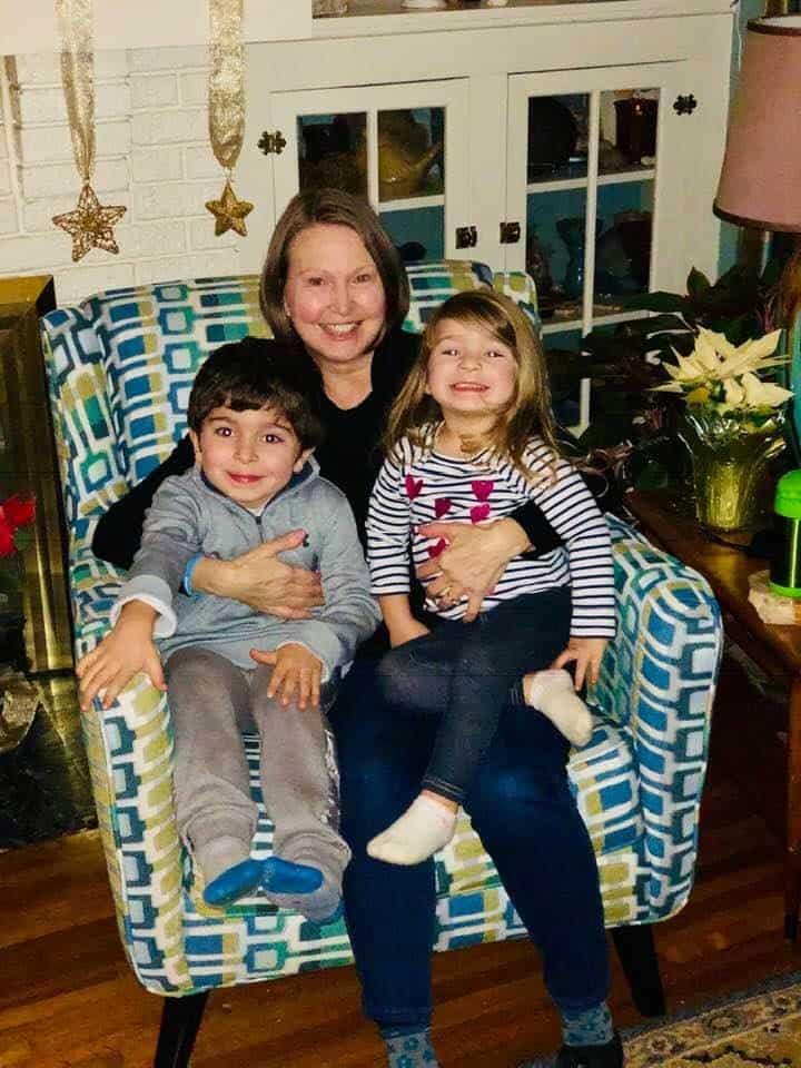 Lung cancer patient Doris Castevens hugs two small children.