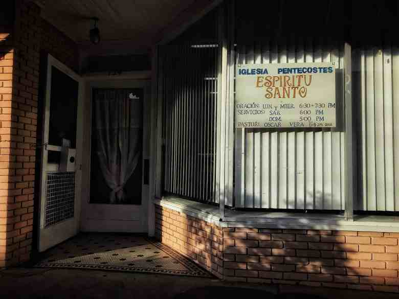 A small storefront has become a Latino church: Espiritu Santo reads the sign. Siler City has one of the highest rates of COVID infection in North Carolina