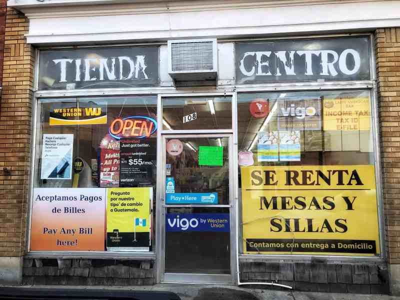 A small storefront has become a Latino grocery store called Tienda Centro reads the sign. Siler City has one of the highest rates of COVID infection in North Carolina