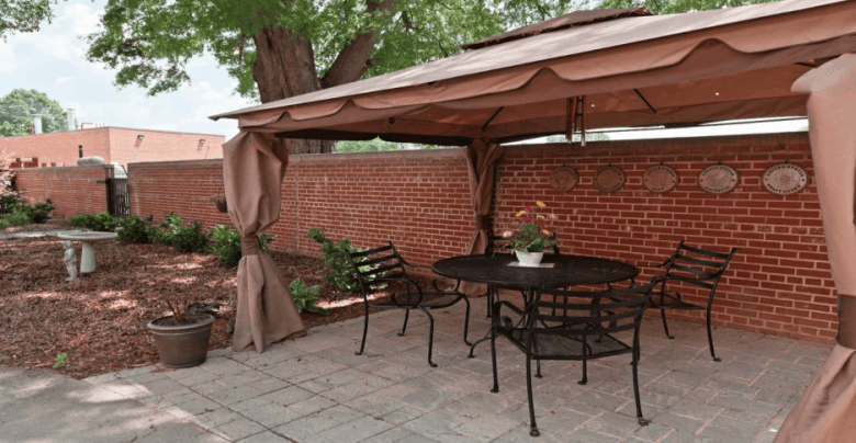 Shows a patio with an awning against a brick wall that has brass plaques hanging on it. It's from a faacility for veterans in Salisbury North Carolina.