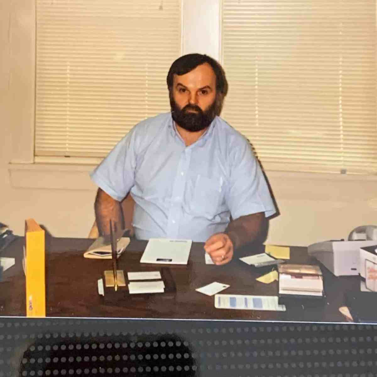 We see James Hill, a wide-eyed, curious looking Canadian doctor with a thick beard and dollop of black hair, at his desk prior to his incarceration in a U.S. federal prison in 2007.