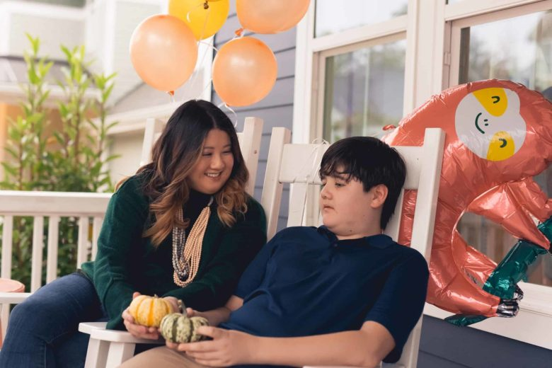 Mom and son sitting on a front porch
