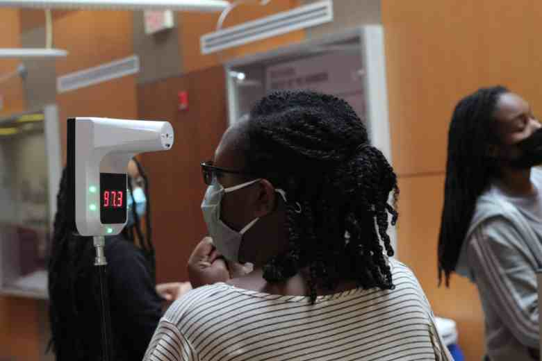 an NCCU student gets her temperature checked before entering the school's cafeteria