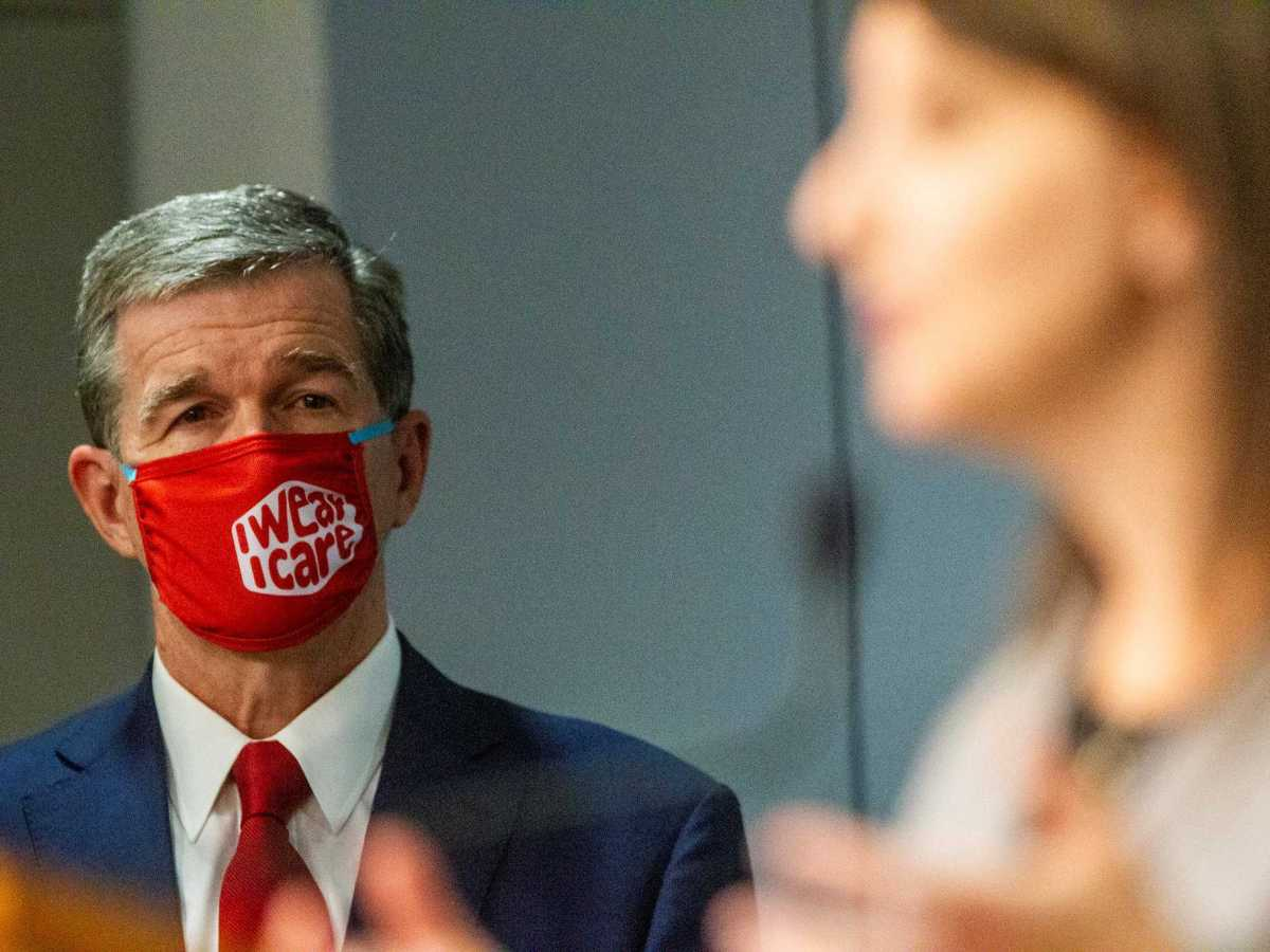 """shows a man in a mask against COVID-19 that reads: """"I wear, I care"""""""