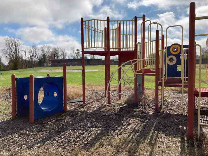 Brightly colored playground equipment behind W.M. Hampton Elementary School, where contamination has been found. Photo credit: Greg Barnes