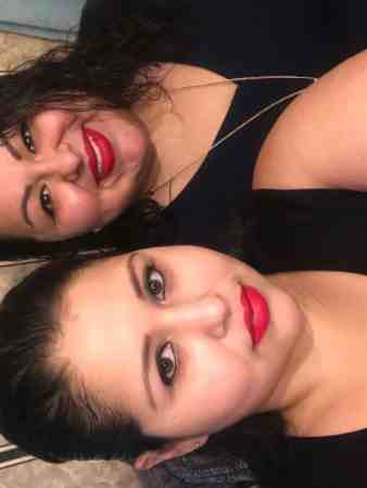 Two sisters are posing for the camera. One of them is Crystal Garcia, the other is Dulce Garcia, who lost her life to coronavirus in May