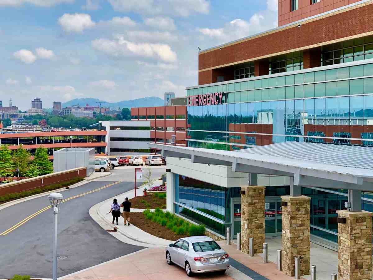 the photo shows the front of Mission Hospital's ER with a car parked out front