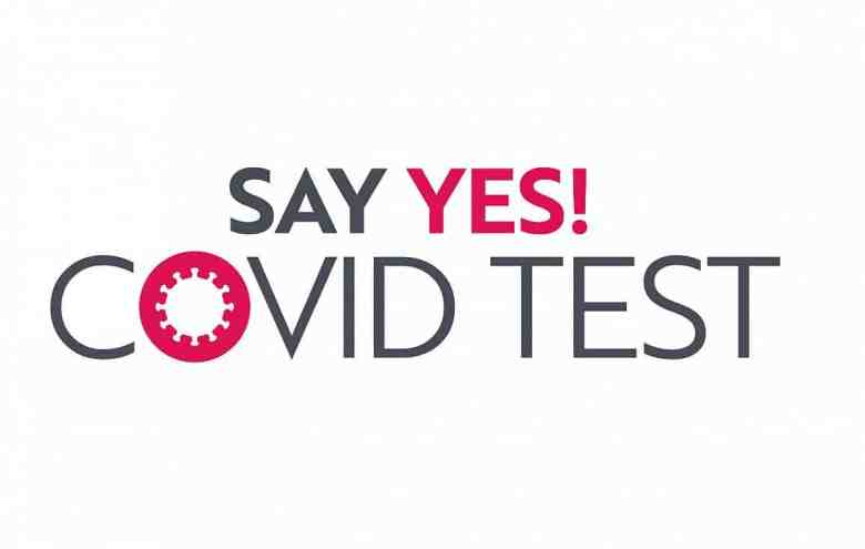 Image is words that read: Say Yes! COVID test. The O in COVID is in the form of a coronavirus.