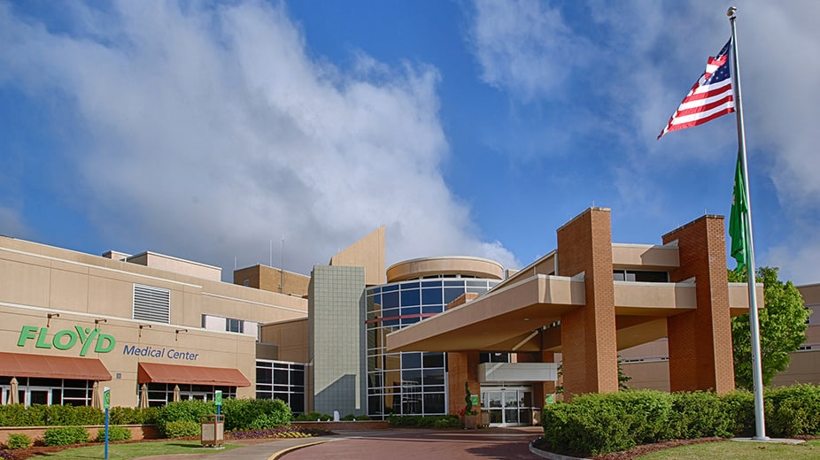 """shows a building that has the words """"Floyd Medical Center"""" on the side of it."""