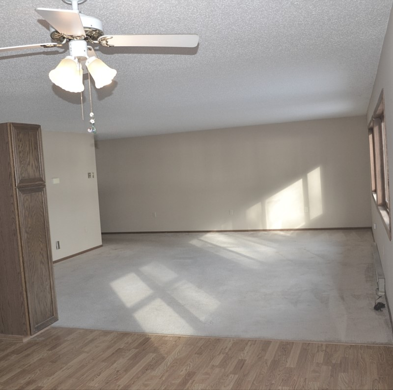 The picture is taken standing in the kitchen, looking towards the mother-in-law apartment.