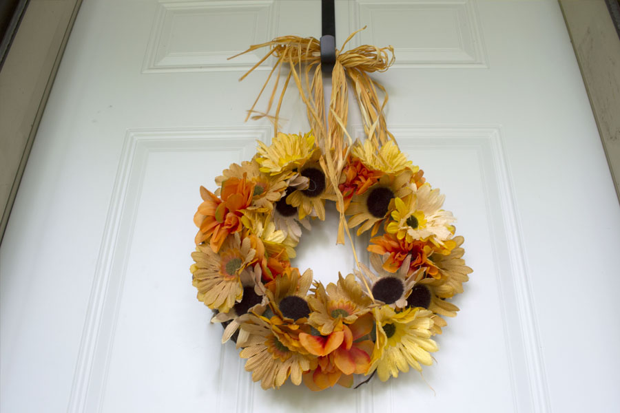 fall wreath hanging from front door