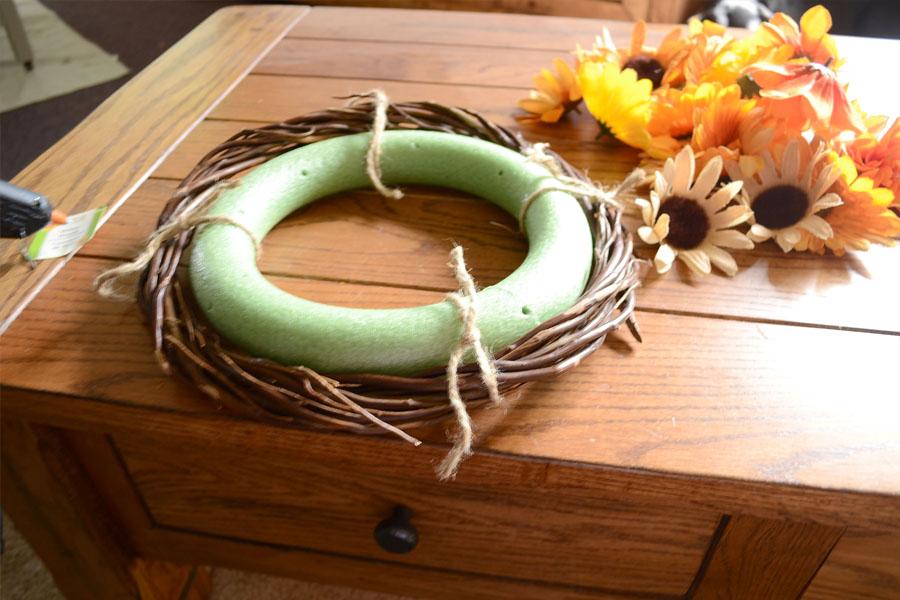 twig wreath form tied to green foam wreath form