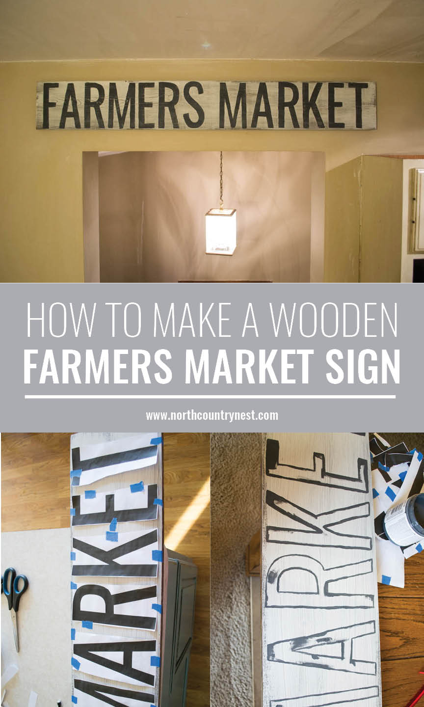 wooden sign saying farmers market