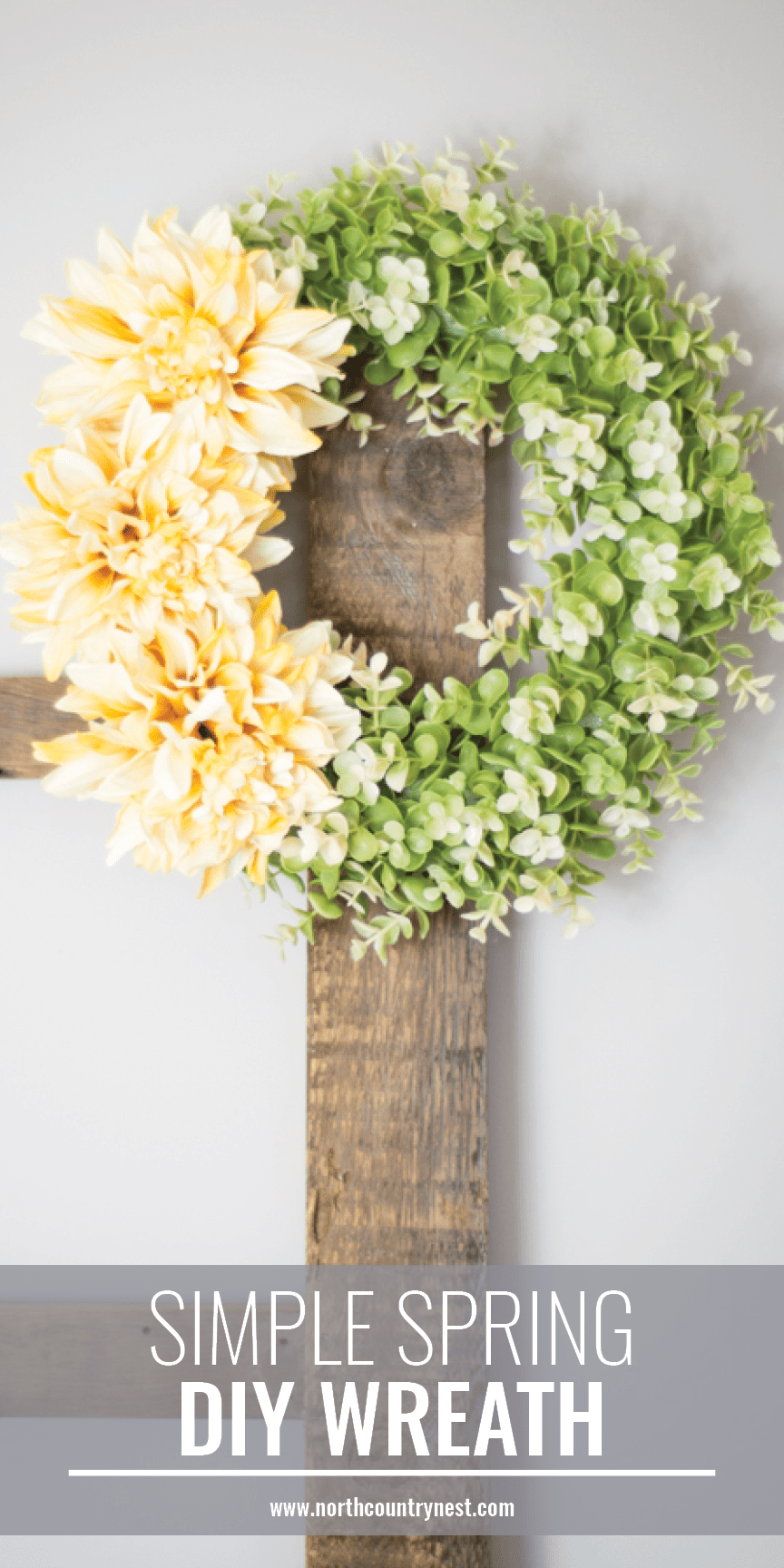 simple spring diy wreath hanging from wooden ladder