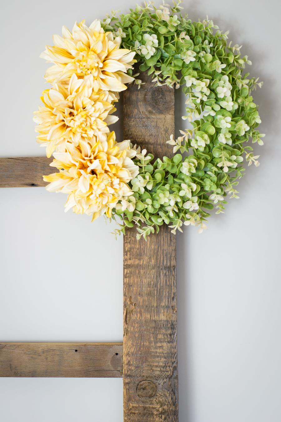 DIY Spring Wreath hanging from blanket ladder
