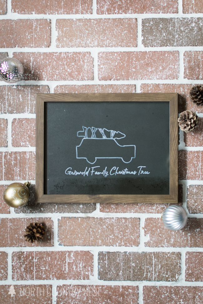 Christmas Vacation chalkboard sign on brick background