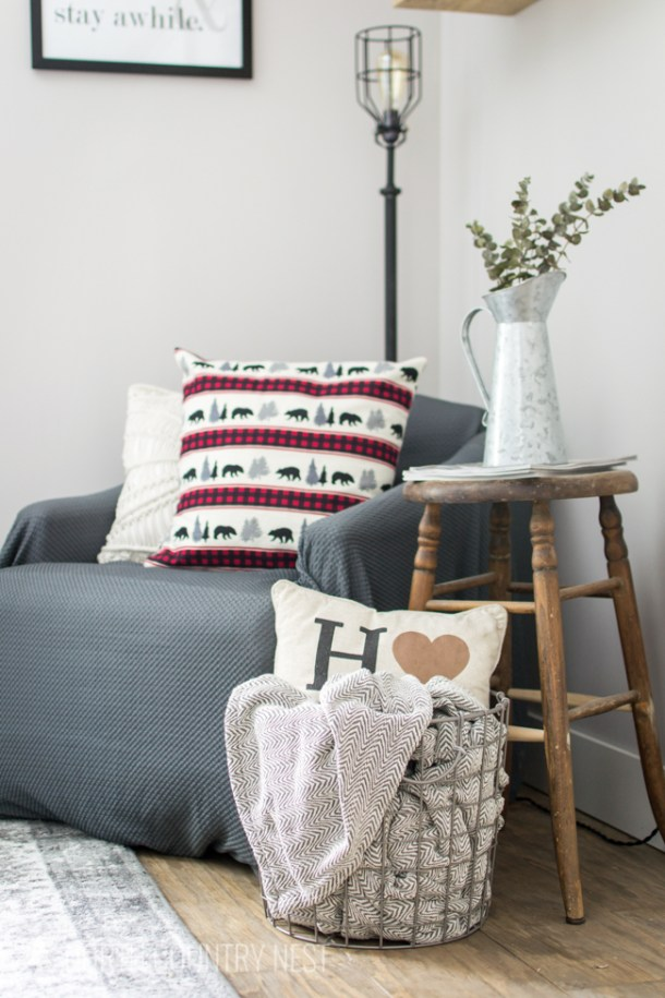cozy winter reading nook with blankets and pillows