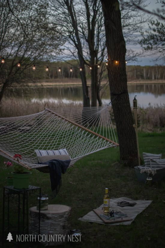 hammock on the lake at night with solar lights