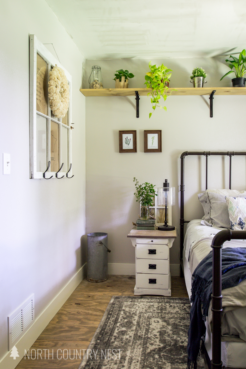 white farmhouse night stand in simple summer bedroom