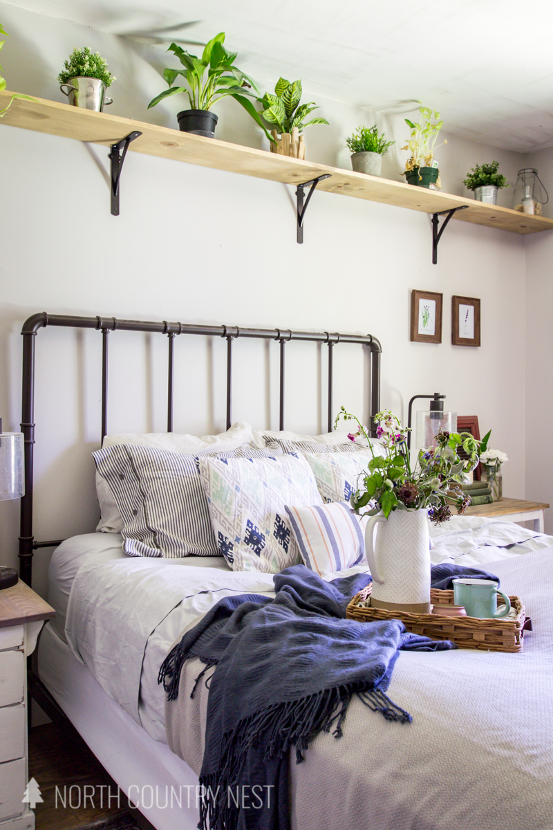 guest bedroom decor with plant shelf