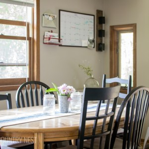 wood kitchen table with black chairs