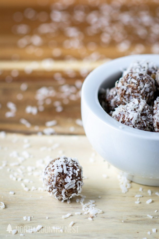 gluten free energy bites in bowl and on wood cutting board