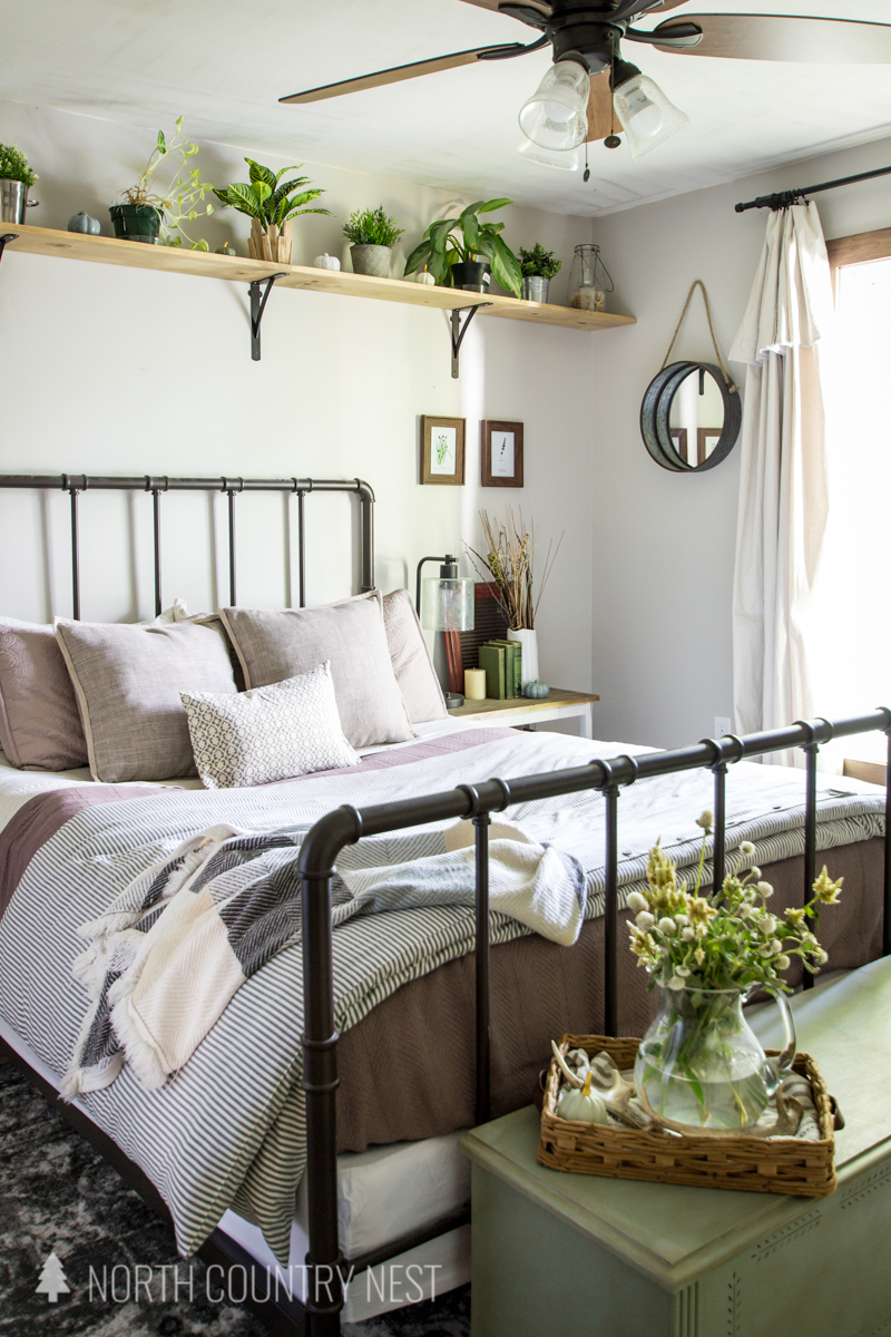 guest bedroom with fall decor