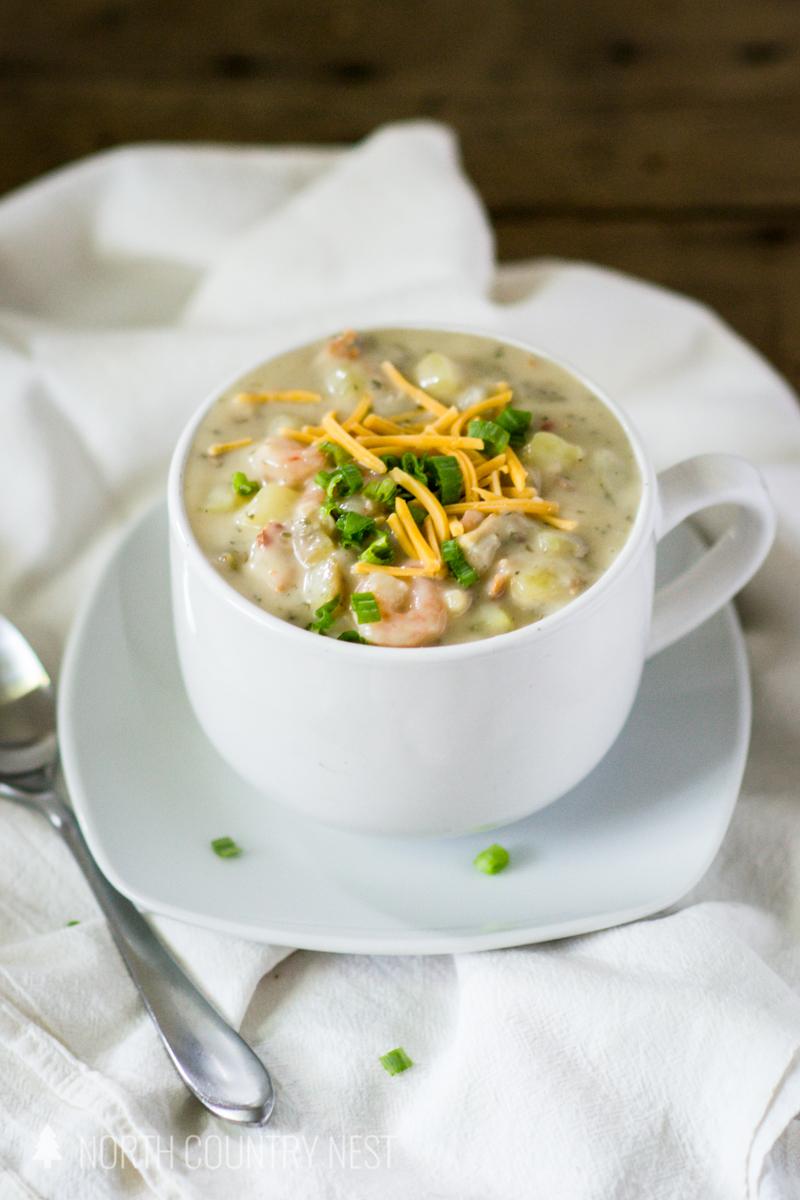 soup in white bowl on white plate on white linen napkin