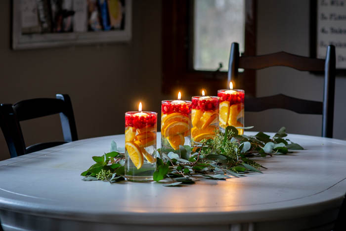 Simple Kitchen Table Centerpiece with Eucalyptus, Oranges and Cranberries
