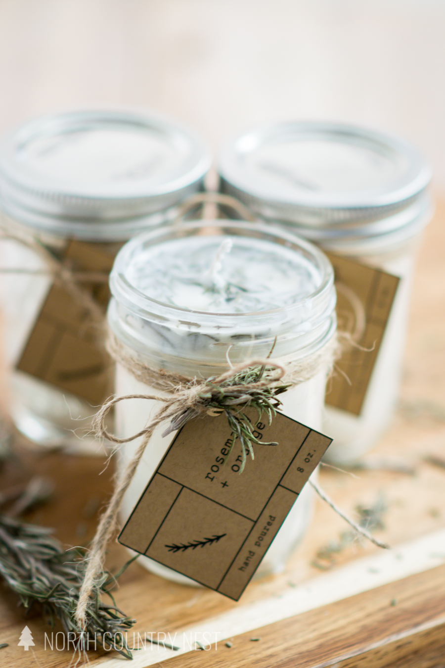 three dried rosemary homemade candles