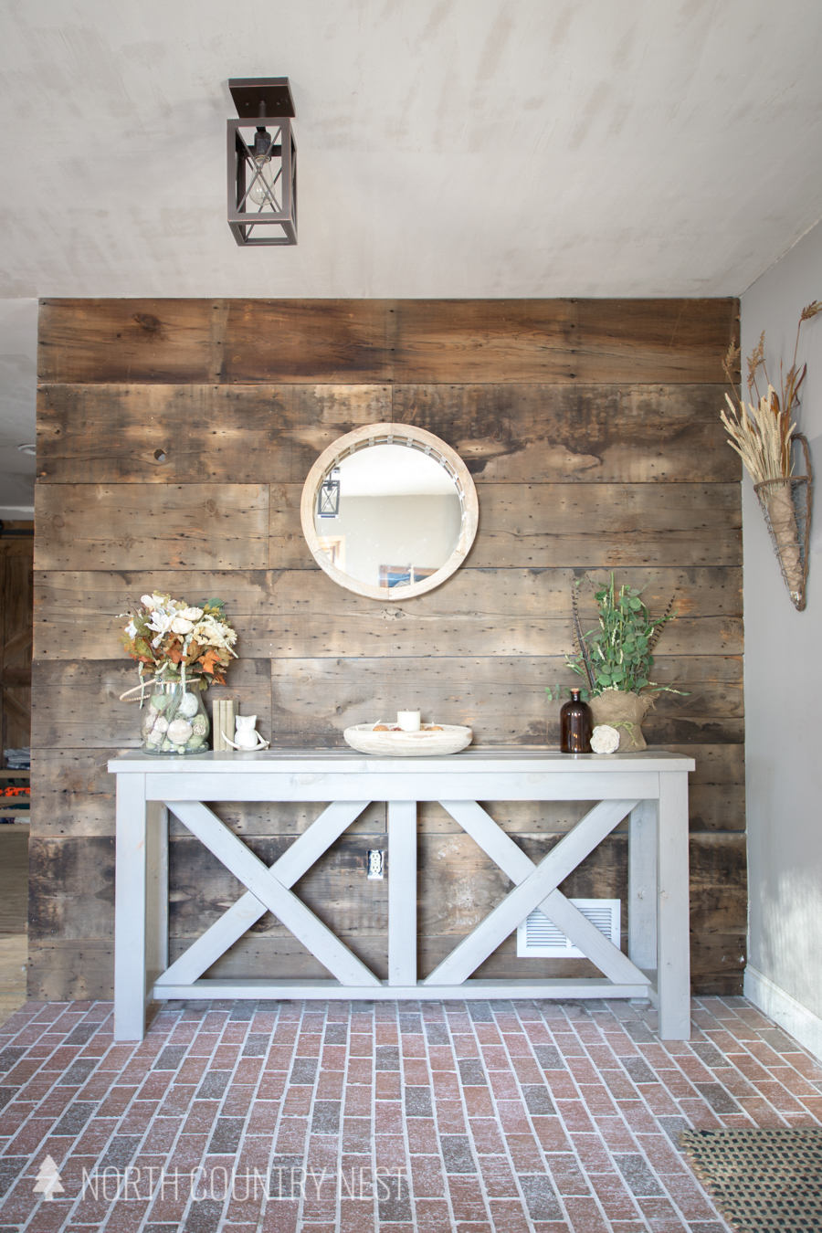 Entryway table decorated with rustic items