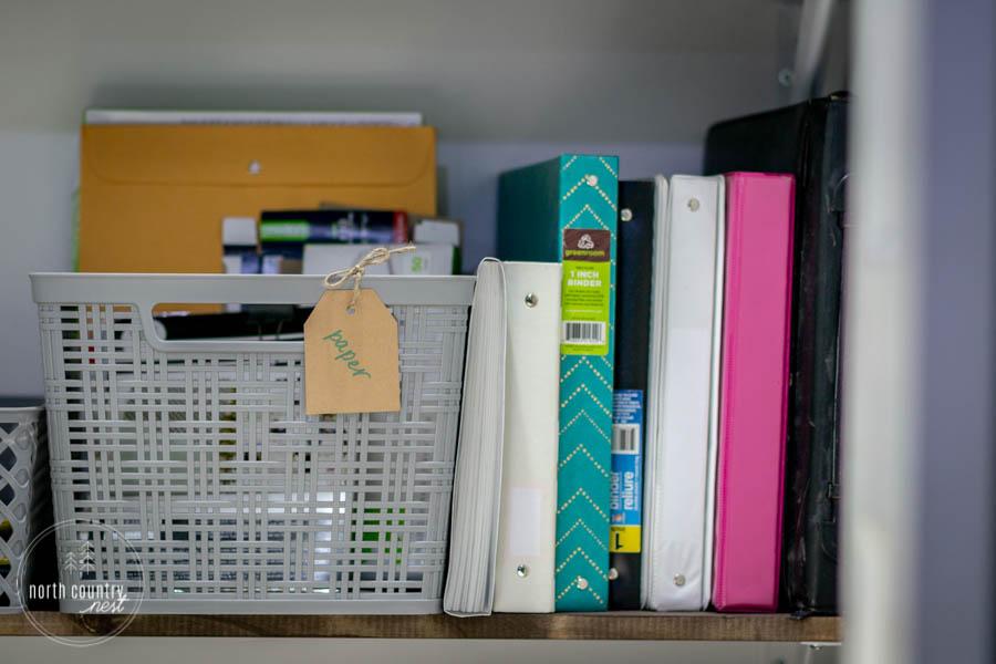 office closet with gray bin