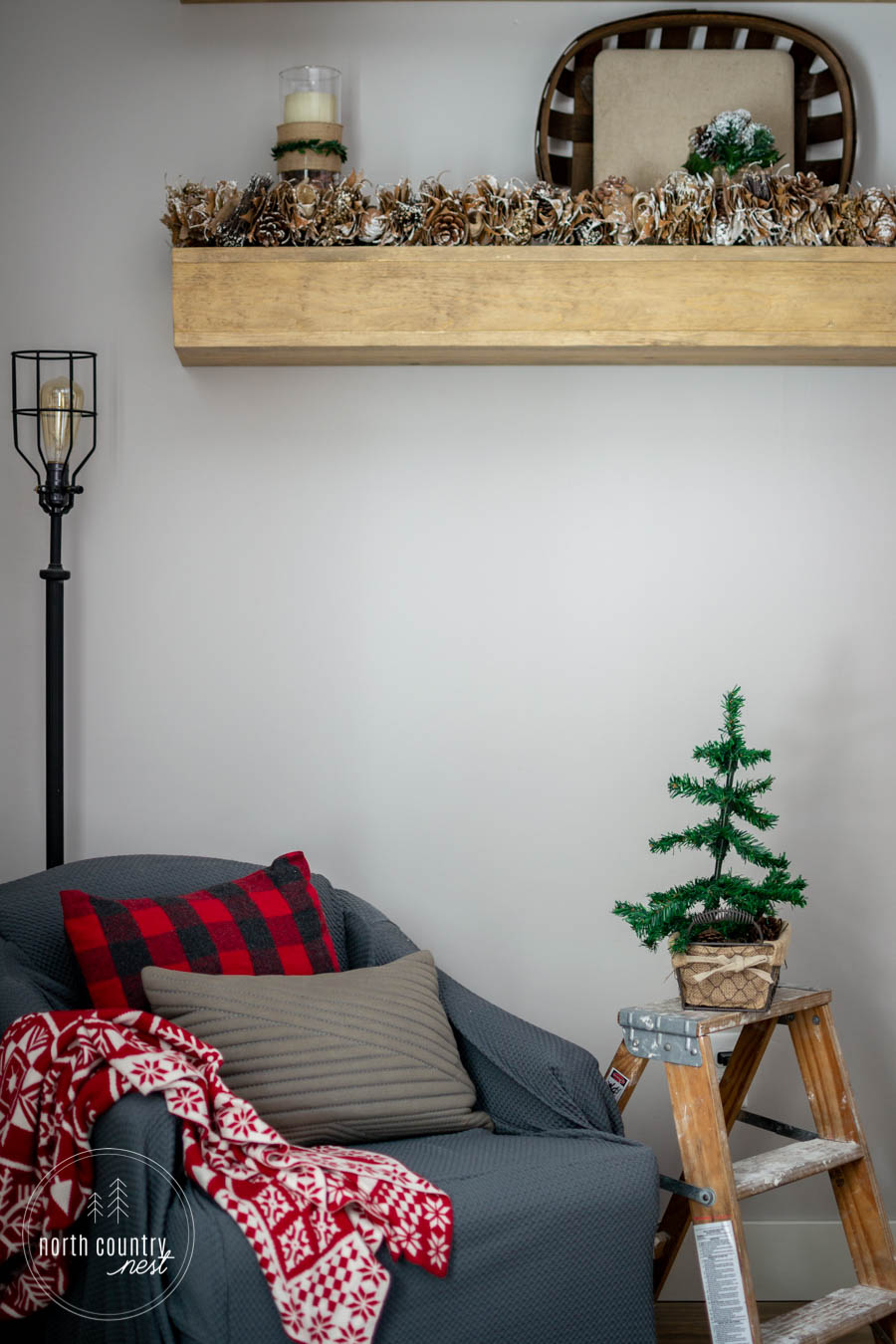 christmas tree and side chair in guest bedroom