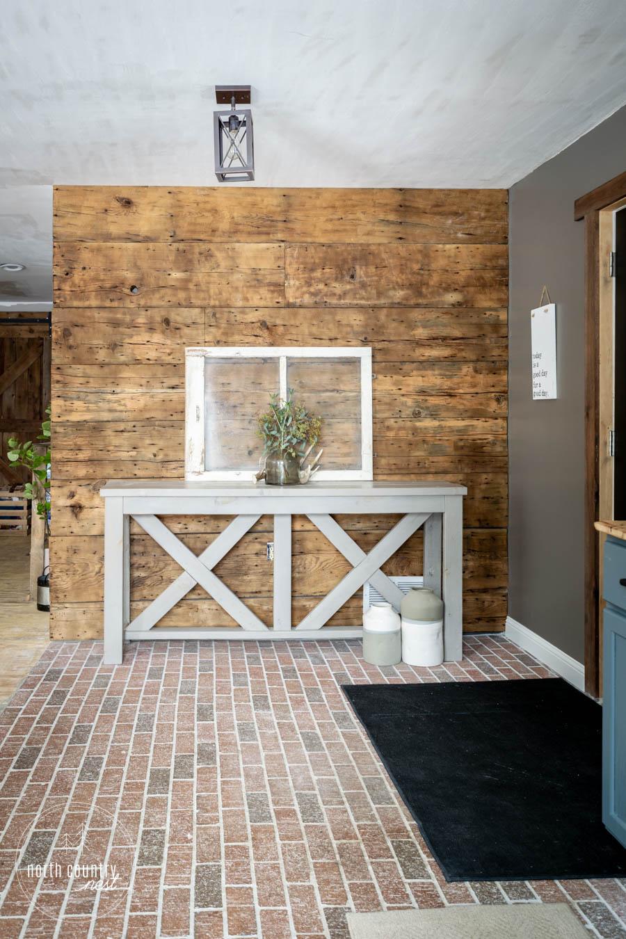 barn wood wall in modern rustic entryway