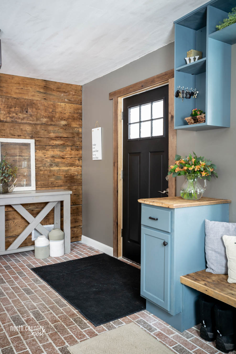 modern rustic entryway with interior black door