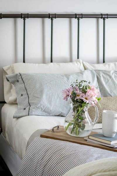 industrial farmhouse bedroom decorated for spring