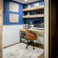rustic home office with blue walls and shiplap