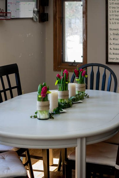 spring floral table centerpiece with pillar candles