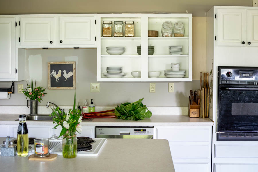open kitchen cabinets in white