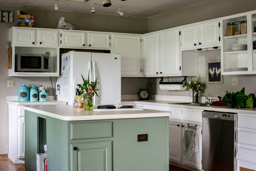 One Year Later: Repainted White Kitchen Cabinets