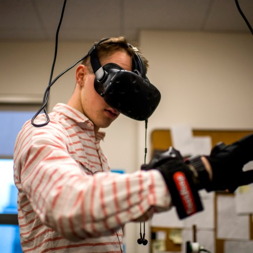 01/22/18 - BOSTON, MA. - Murray Sandmeyer, CIS'20, works on developing VR for physical therapy research in Dr. Danielle Levac's Rehabilitation Games & Virtual Reality Laboratory in Robinson Hall on Jan. 22, 2018. Photo by Matthew Modoono/Northeastern University