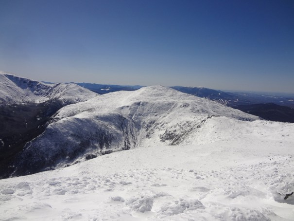 The winter hiking view of Mt. Jefferson as seen from the summit of Mt. Adams in New Hampshire.