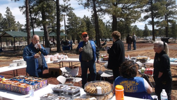 Kiwanis and Lions Club International members serve the food.