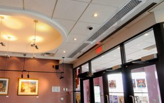 Architectural recessed air curtain sliding door entrance art gallery